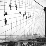 Painters in the wires of the Brooklyn Bridge