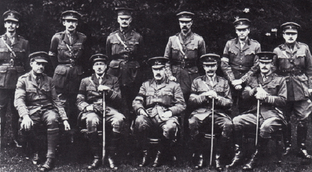 GHQ intelligence staff. Major Stewart Menzies is standing second from the left, and Major James Marshall-Cornwell on the extreme right. Brigadier General Charteris is seated in the middle